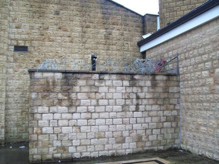 Repair of walled section of commercial building
