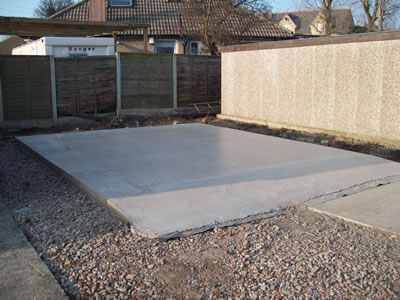 Extended garage base concrete slab concrete base for Base for concrete driveway
