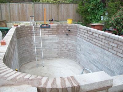Large koi carp pond construction filter room for Koi pond builders uk