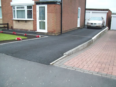 Relaid  Driveway, levelled and new tarmac