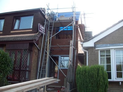 Roof added to double storey house extension