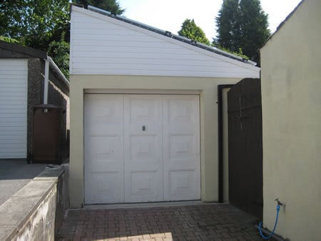 Completed garage, the slope of the roof is clearly visible
