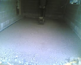 Concrete slab preparation, compacting with a whacker plate
