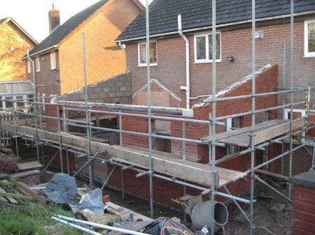 Building of house extension brick walls