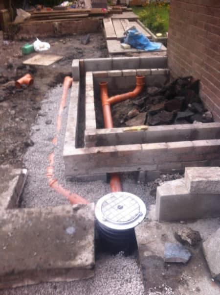 Footings and wet room drains