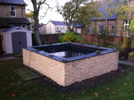Pond finished with marble coping stones