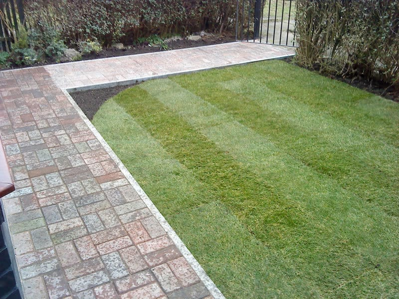 Landscaping of small front city garden with block paving